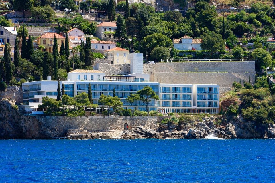 View to Villa Dubrovnik hotel from the sea towards the Island of Lokrum, showing the hotel bedrooms and landscape