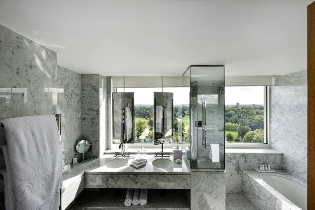 Marble bathroom at the Royal Lancaster London Hotel with a view overlooking Hyde Park in London