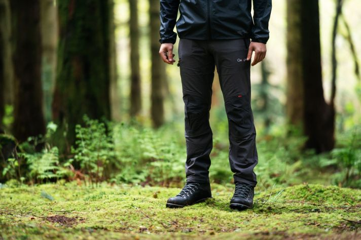 Berghaus Hiking Clothing for Men - with a man in a forest wearing walking trousers.