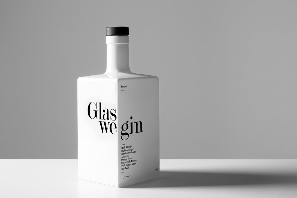A square bottle of Glaswegin on a white table and a light grey background.