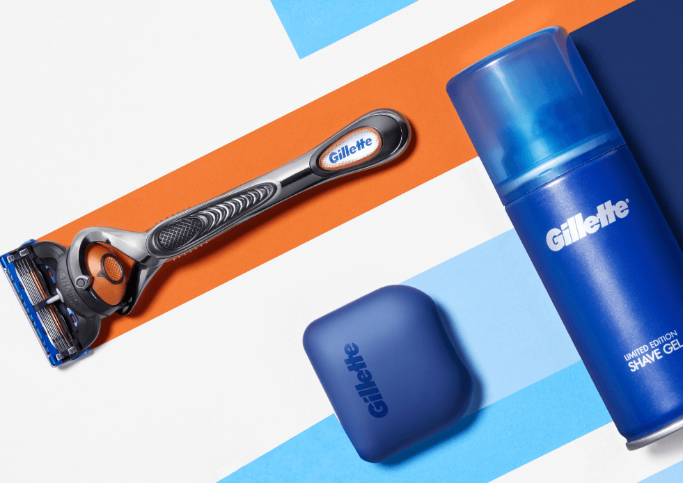 A range of gillette shaving products on a coloured background.